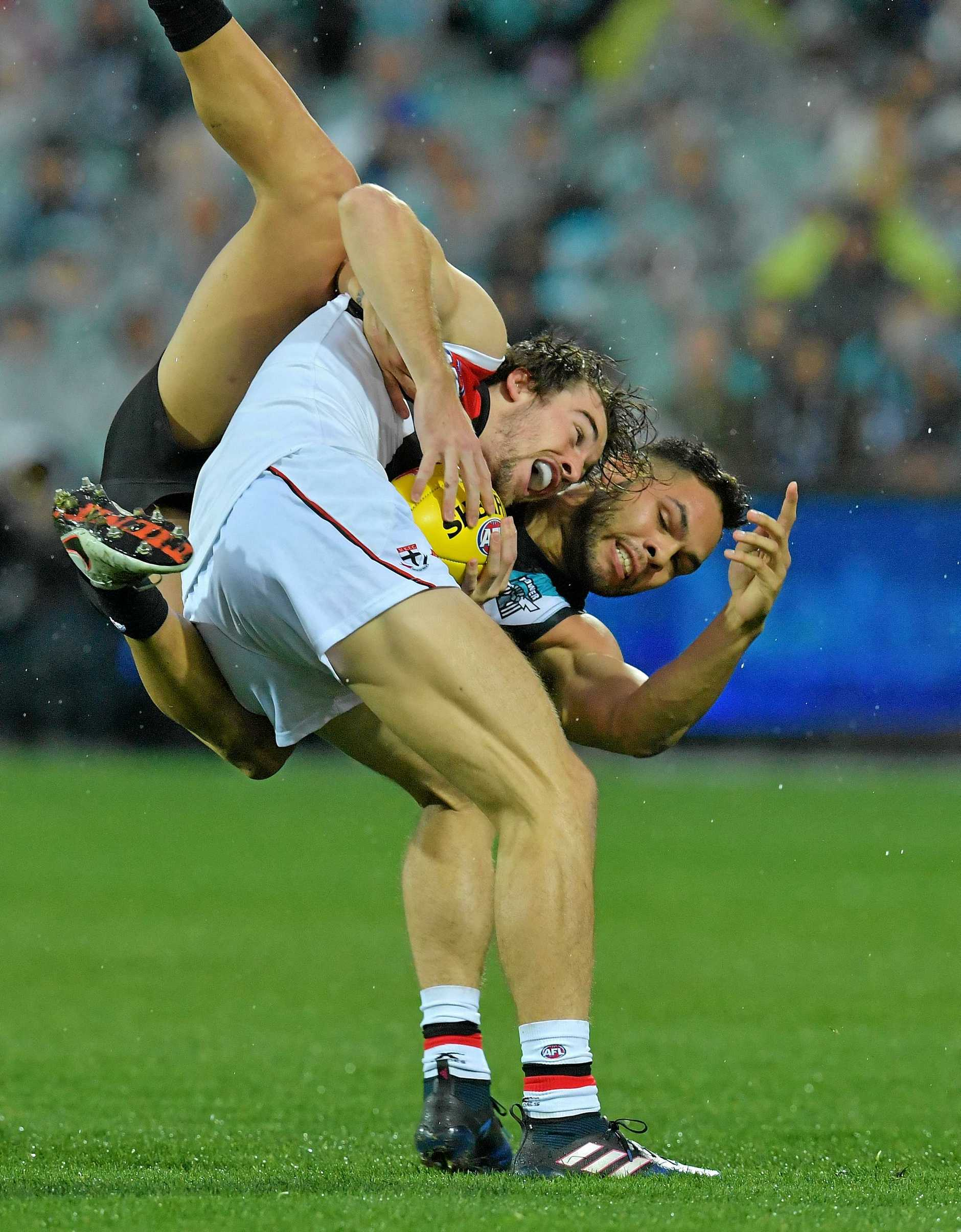 Jarman Impey of the Power (right) and Daniel McKenzie of the Saints contest the ball during the Round 19 AFL match between the Port Adelaide Power and the St Kilda Saints at Adelaide Oval in Adelaide, Saturday July 29, 2017. (AAP Image/David Mariuz) NO ARCHIVING, EDITORIAL USE ONLY