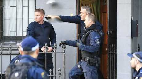 Police outside the Surry Hills terrace house. Picture: Dylan Robinson