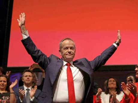 Leader of the Opposition Bill Shorten greets the crowd after delivering a speech during the NSW State Labor Conference at Sydney Town Hall, in Sydney, Sunday, July 30, 2017.