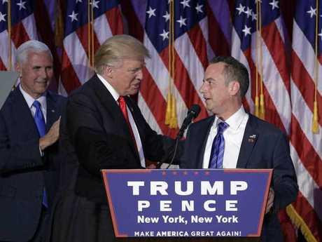 Reince Priebus (R) embraces Donald Trump (L) during election night.