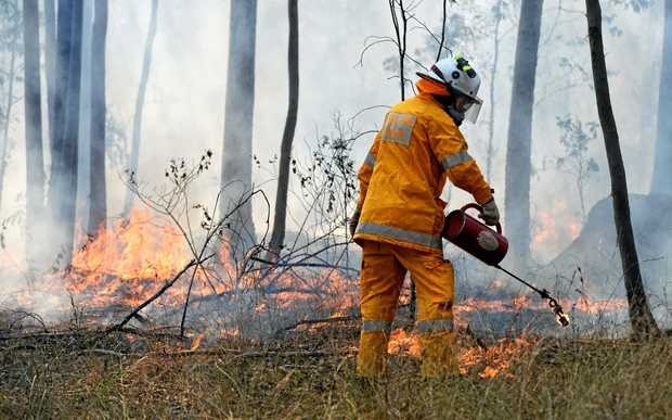 HAZARD REDUCTION: Council hazard reduction burn crews work closely with the Queensland Fire and Emergency Services to undertake planned burns.