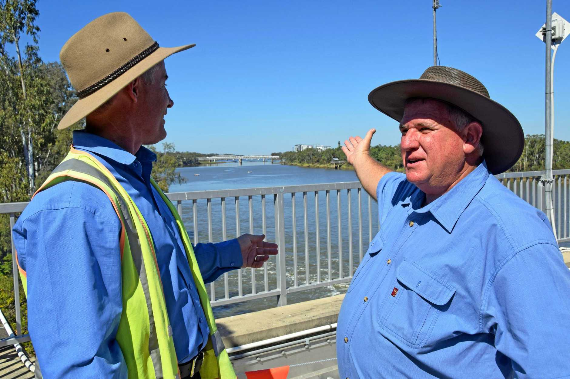 Fitzroy River Water manager Jason Plumb and Rockhampton region councillor Neil Fisher take in the view from the top at the Fitzroy Barrage Open Day on Saturday.