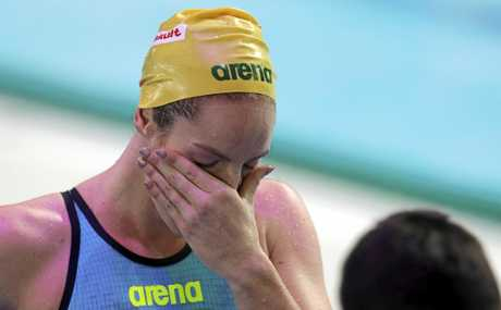 Australia's Emily Seebohm breaks down after her gold-medal swim in the 200m backstroke.