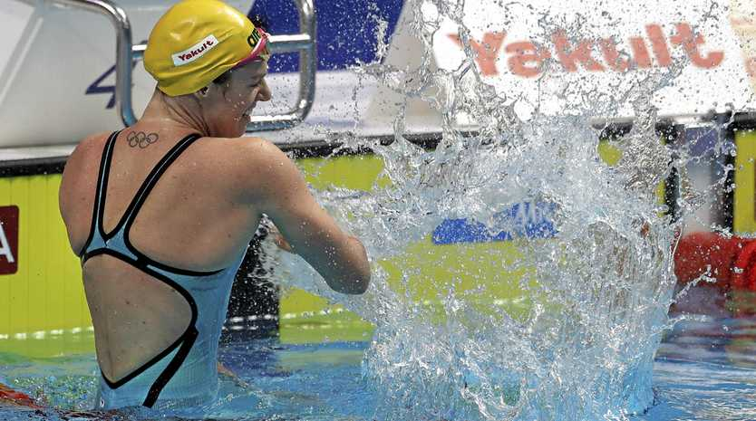 Australia's Emily Seebohm celebrates after winning gold in the women's 200m backstroke final at the Swimming World Championships in Budapest.