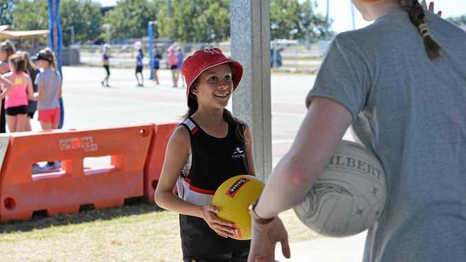 Maddison Bancroft looking up to Sunshine Coast Lightning player Madeline McAuliffe at the coaching clinic.