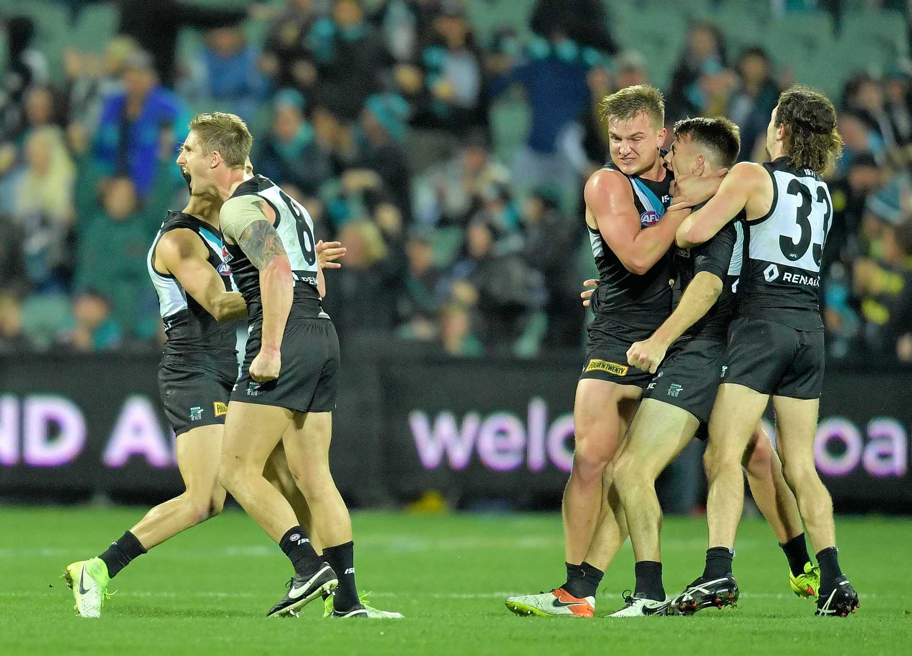 Robbie Gray of the Power (second right) celebrates with teammates after kicking the winning goal against St Kilda.