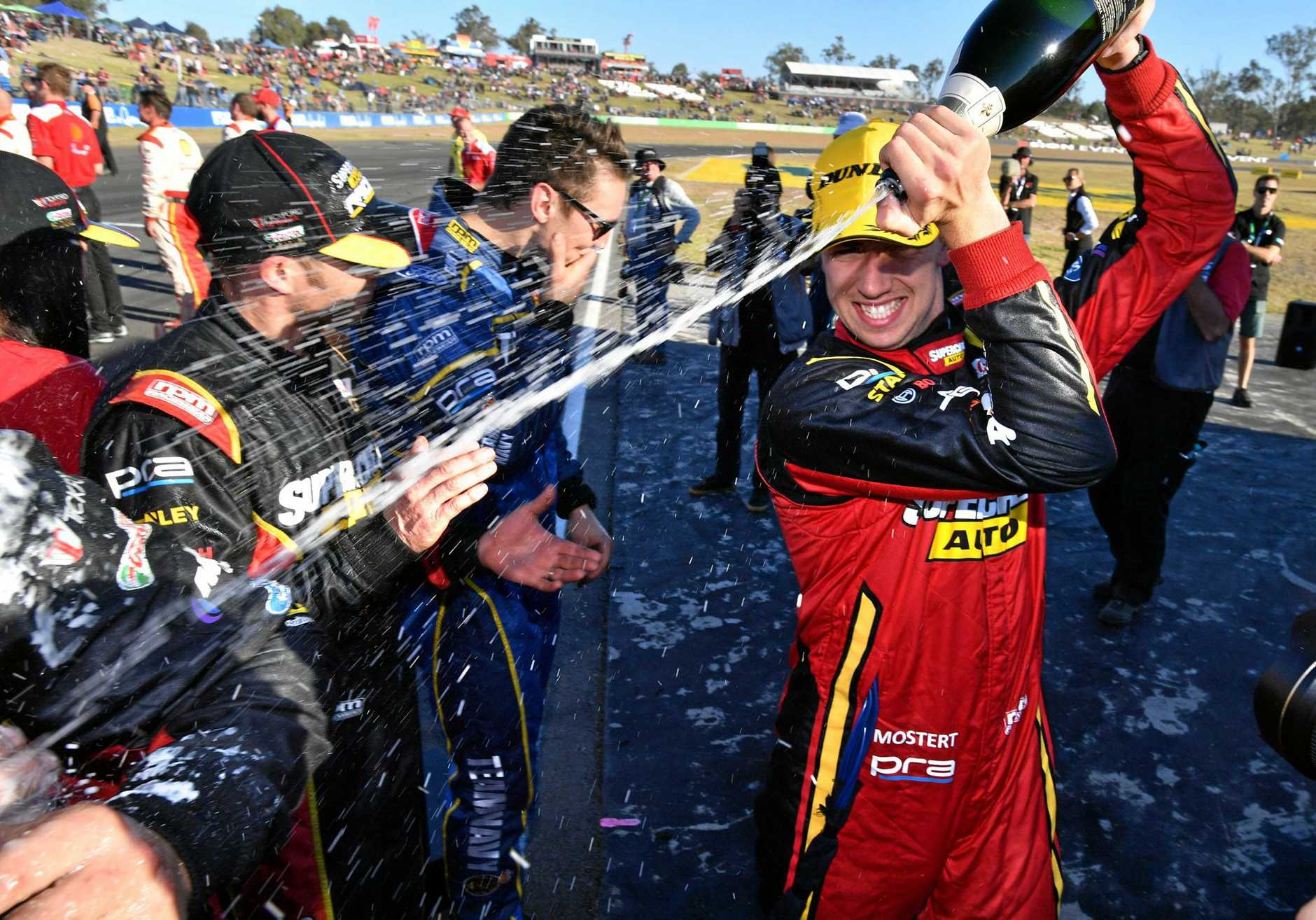 Chaz Mostert (right) celebrates with members of the Supercheap Auto Racing Ford Falcon team.