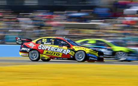 Chaz Mostert pilots his Ford up the inside during the Super Sprint event at Ipswich.