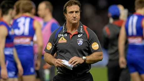Bulldogs coach Luke Beveridge leaves the field after talking to his players during a break.