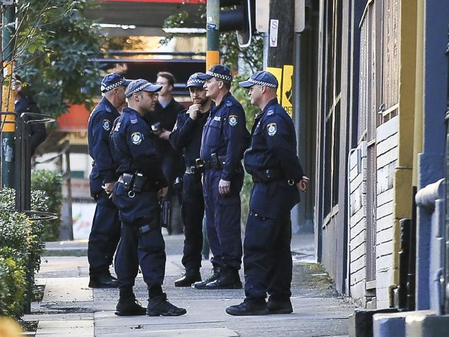 Police raid a house in Surry Hills, closing off a portion of Cleveland St.