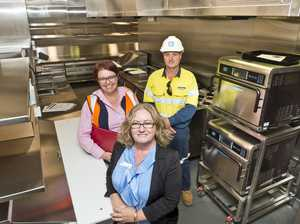 Cooks in the new kitchen early at St Vincent's
