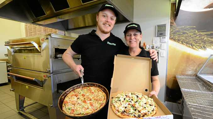 NEW ADDITION: Jessee and Tracey Heilbronn from Pizza Plus in Raceview and North Ipswich. INSET: Jessee hard at work.