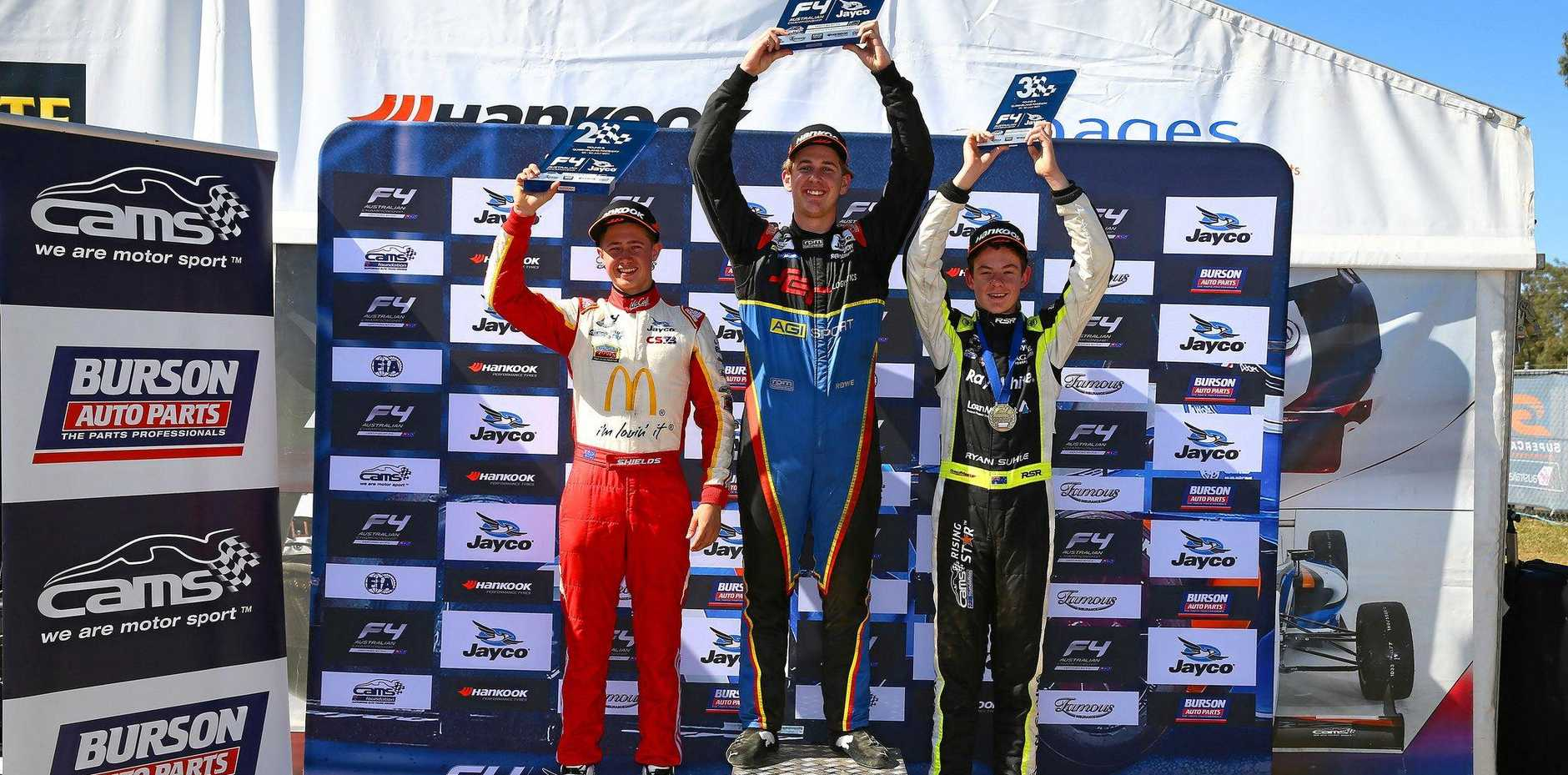 ON THE PODIUM: Toowoomba driver Cameron Shields (left) after finishing second at the Ipswich round fo the Australian Formula 4 Championship, with round winner Nick Rowe and third-placed Ryan Suhle.