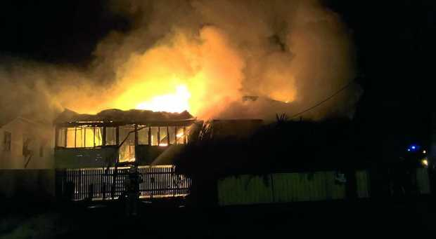 A house in Rockhampton engulfed in flames in the early hours of Monday morning.