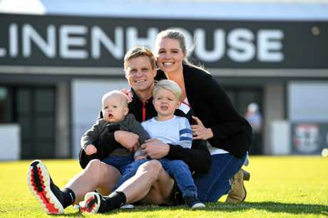 Riewoldt poses for photos with his wife Catherine, and sons James and Will