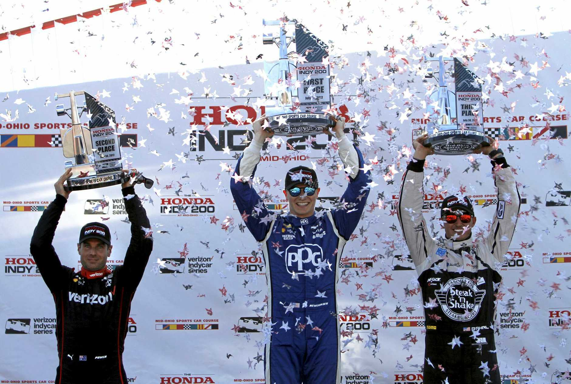 Second-place finisher Will Power, right, winner Josef Newgarden, center, and third-place finisher Graham Rahal raise their trophies in Victory Lane at the IndyCar Honda Indy 200