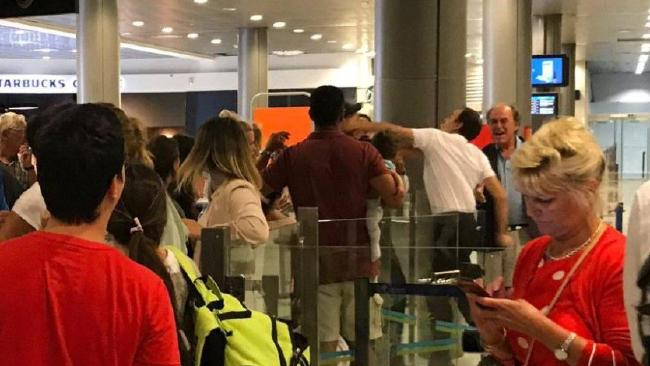 An airport worker was pictured appearing to punch an easyJet passenger at Nice.