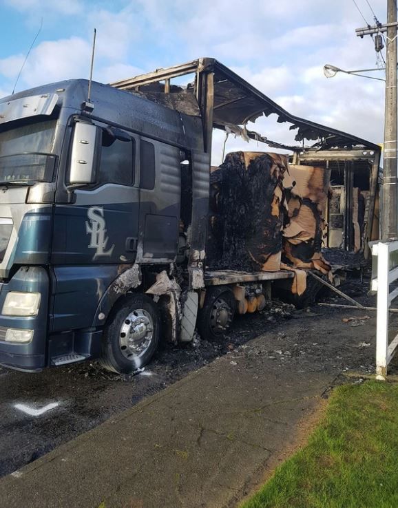 The fully laden truck was shunted over a metre and left a burned-out wreck.