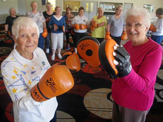 Great-grandmothers Elise Griffin and Norma Makowski learn how to throw a punch with their friends at Fitzgibbon's Golden Downs.