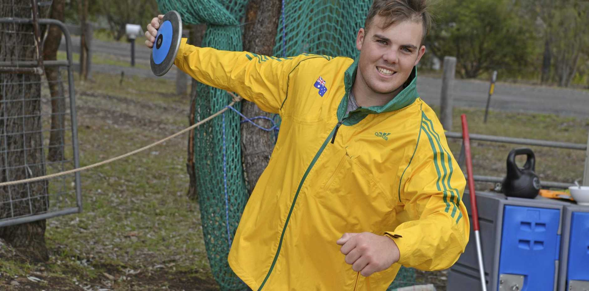 GAMES HOPES: Allora thrower Matthew Denny on his home throwing circle before heading to the Olympics. He is now aiming for the Commonwealth Games in discus and hammer.