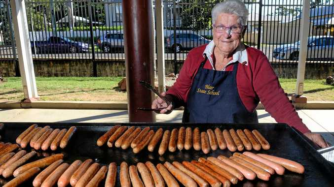 STALWART: Volunteer Rita Langer cooks up a storm at the annual Blair State School State of Origin BBQ.