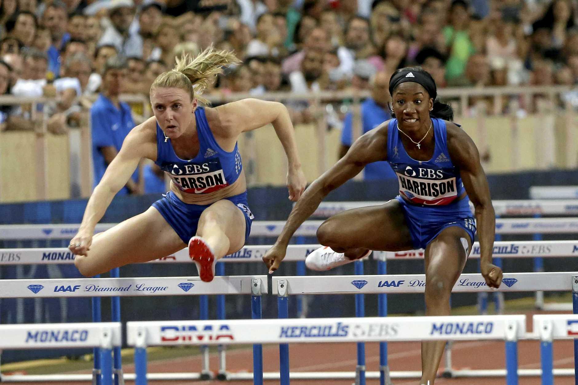 Australia's Sally Pearson (left) racing the USA's Kendra Harrison in the women' s 100m hurdles at the IAAF Diamond League meeting in Monaco.
