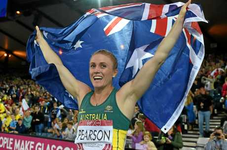 Australian athlete Sally Pearson celebrates after winning gold in the women's 100m hurdles final at the 2014 Commonwealth Games in Glasgow.