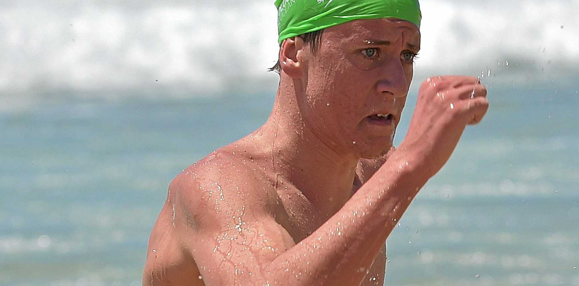 TALENTED: Nick Sloman emerges from the water after a Mooloolaba swim.