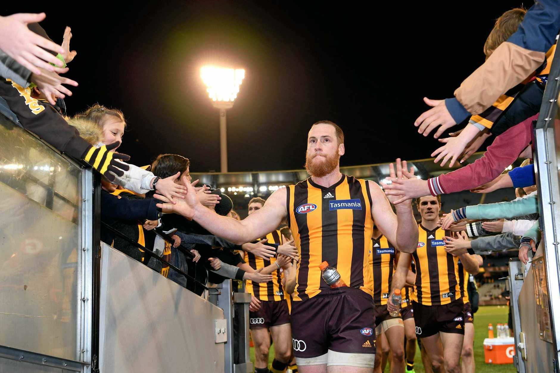 Jarryd Roughead of the Hawks celebrates with fans after the side's win, during the round 15 AFL match between the Hawthorn Hawks and Collingwood Magpies, at the MCG in Melbourne, Sunday, July 2, 2017. (AAP Image/Joe Castro) NO ARCHIVING