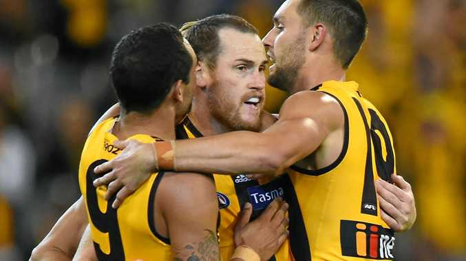 Hawthorn captain Jarryd Roughead (centre) celebrates his 500th goal with teammates.