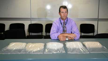 Detective Senior Sergeant Luke Peachey with over 5kg of ice found in a car in Rockhampton.