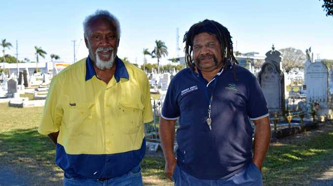 PROUD: Elton Backo and Starret Vea Vea at the Mackay cemetery, where a year-long project has sought to identify 114 unmarked graves belonging to South Sea Islanders.