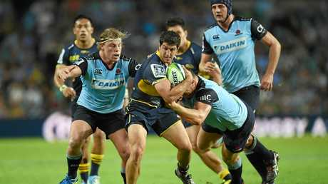 Tomas Cubelli of the Brumbies is tackled by Hugh Roach and Paddy Ryan of the Waratahs last year.