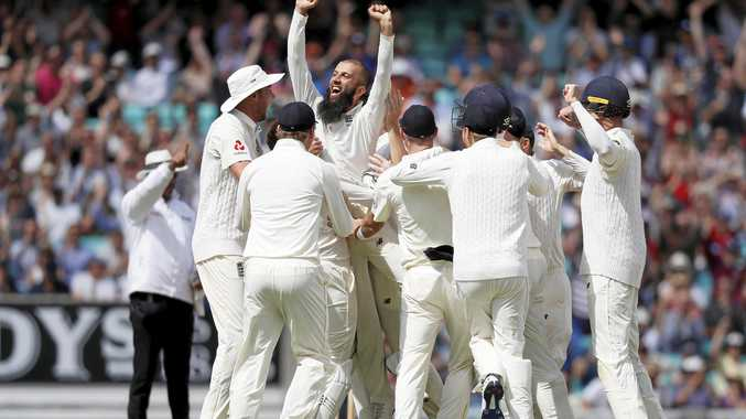 England's Moeen Ali is lifted by his teammates after claimed a hat-trick against South Africa.