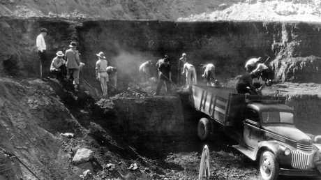 VITAL WORK: Mackay City Council senior staff oversee the loading of coal at the Bee Creek deposit, urgently needed to keep the city supplied with electricity during a nation-wide coal miners' strike in 1949.
