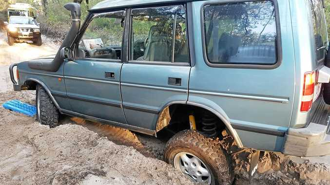 STUCK: One of the latest bog victims on the 'I got bogged at Inskip Point' Facebook page. This four wheel drive got stuck on the inland track at Fraser Island.