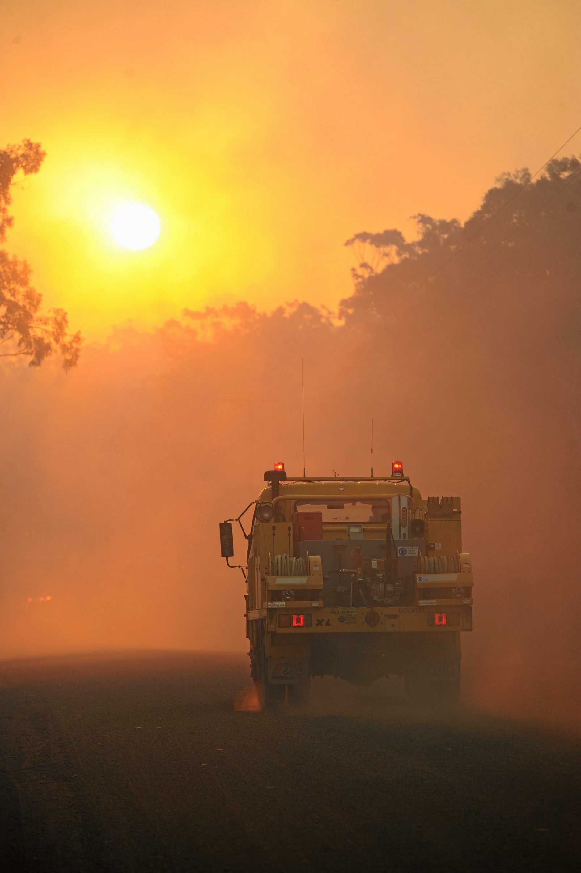 Rural fireys head up to the end of Sunnyside Drive, Susan River to control a fire.  Photo: Alistair Brightman / Fraser Coast Chronicle