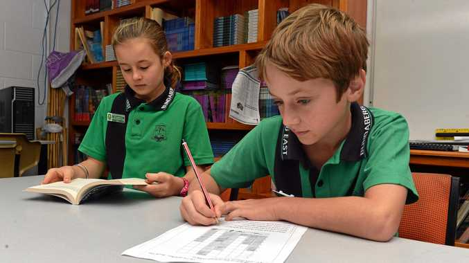 READING AND WRITING: Ella Bigg and Steven Pozzebon from Bundaberg East State School doing Naplan tests.