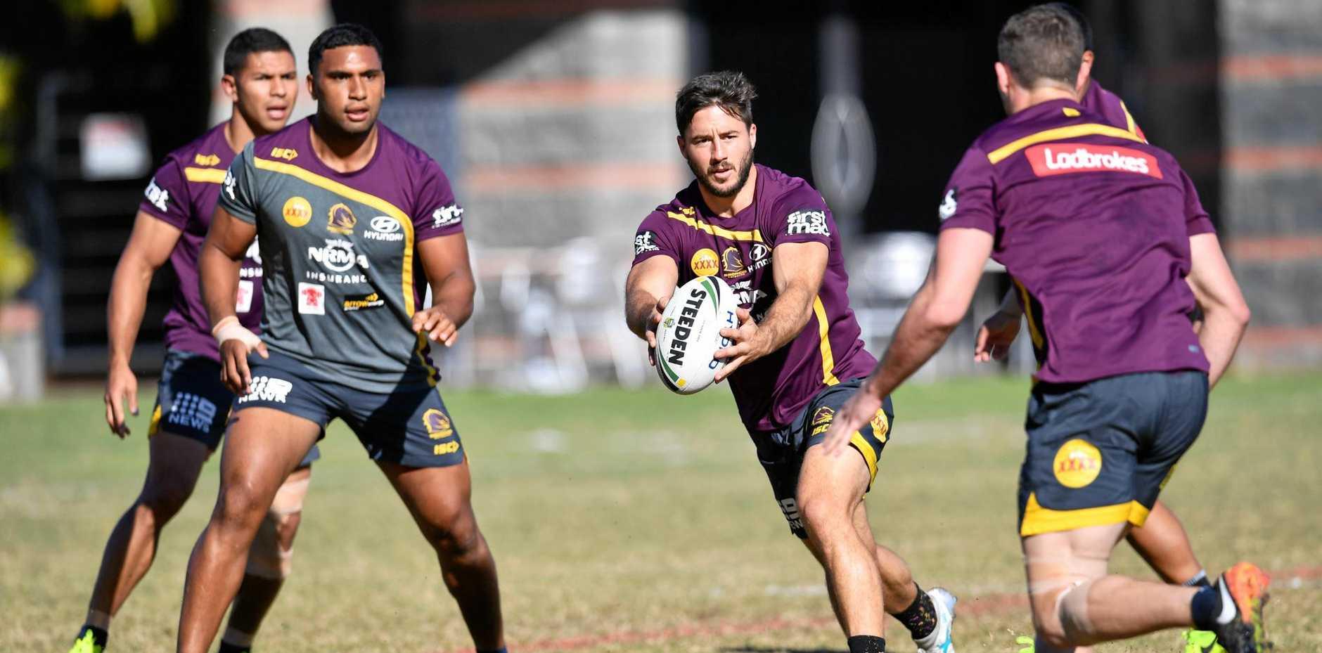 Brisbane Broncos player Ben Hunt (centre) during a training session in Brisbane.