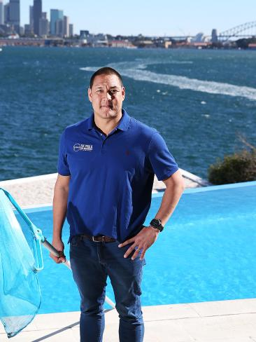 Former Olympic swimmer Geoff Huegill at work in Point Piper Picture: Danny Aarons