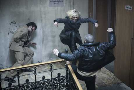 Charlize Theron, center, in a scene from Atomic Blonde.