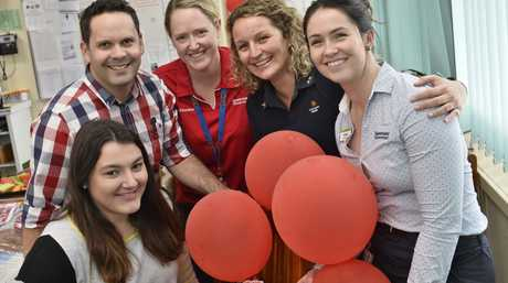LUCKY TO BE HERE: Elizabeth Ernst (front) returns to Toowoomba Hospital to thank staff (from left) Dr Blair Rasmussen, nurses Catherine McNally, Peta Land and Frankie Stock who gave lifesaving first aid after she collapsed on the netball court.