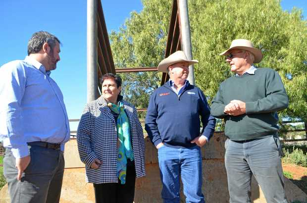 ON TRACK: At the old Morven rail loading dock are NH Foods export sales manager, Murweh shire mayor Annie Liston, Oakey Beef general manager Pat Gleeson and Paroo mayor Lindsay Godfrey.