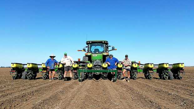 IN THE FIELD: Sealy Farmer, John Reeves, Paul Yates and John Hegeman at Lochiel, Emerald, planting early season cotton.