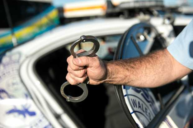 Police arrested a man after he crashed into a tree on the NSW North Coast.