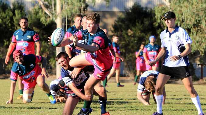 ABOVE: Joseph Fabish offloading the ball at the Emerald Rams' Ladies' Day.