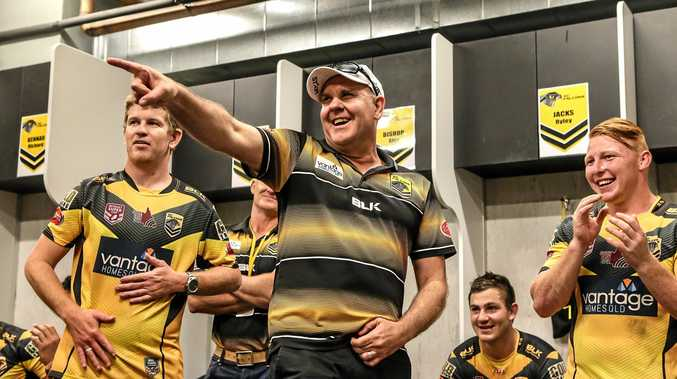 GOOD TIMES: Sunshine Coast Falcons coach Craig Ingebrigtsen celebrates with players after a clutch win over Wynnum-Manly last year.