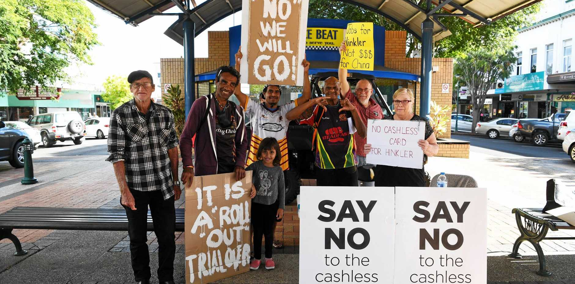 SAY NO: Dennis Ludwick, Katani Eseki, Samia Mangus, Peter Saunders, Clinton Tanna, Ric Glass and Jeeni Lawrence at a Cashless Debit Card protest in Bundy last month.
