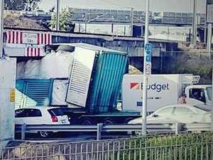 Truck smashes into bridge, causing road and rail chaos