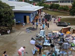 Scientists help clean up flood contaminated school site